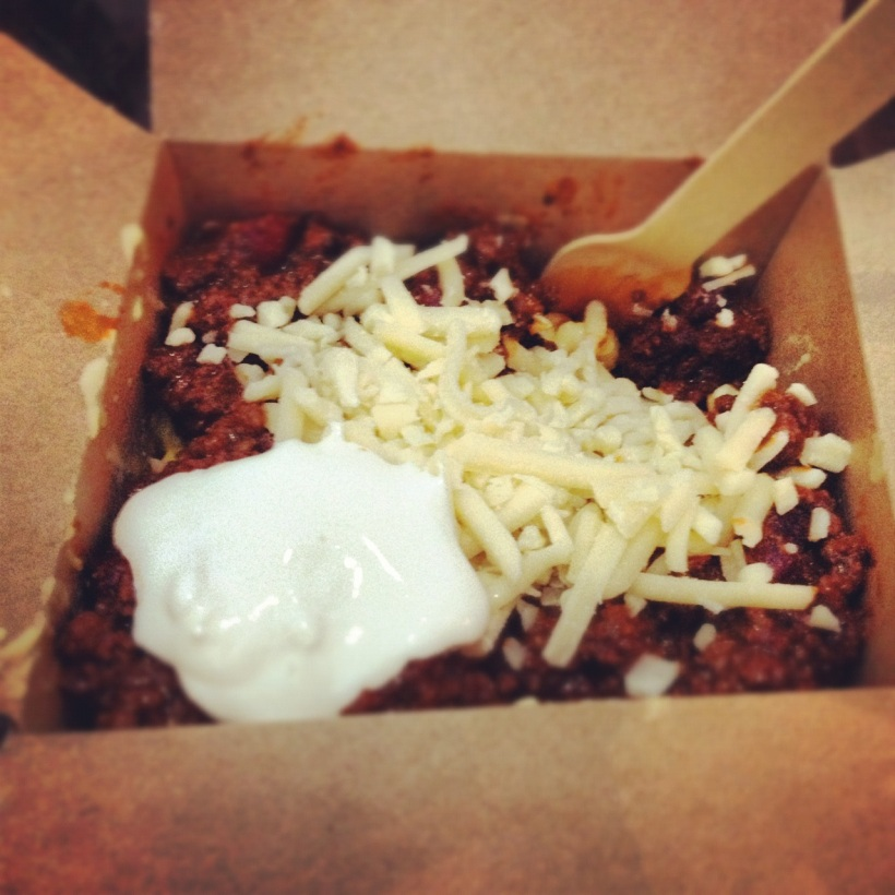 Texas beef chilli over macaroni & cheese. The chilli was subtly flavored with cocoa.
